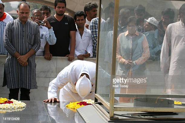 Anticorruption activist Anna Hazare prays at Rajghat before staring his day long fast in protest against corruption in New Delhi on Sunday