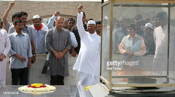 Anticorruption activist Anna Hazare shout slogans with his supporters at Rajghat before his day long fast in New Delhi on Sunday