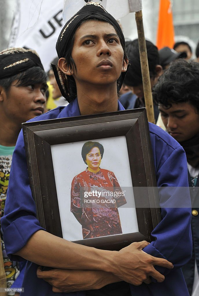 Anti-corruption demonstrators display the portrait of resigned finance minister Sri Mulyani Indrawati during a rally in Jakarta on May 20, 2010. Yudhoyono appointed PT Bank Mandiri chief Agus Martowardojo as the new finance minister after the shock resignation of independent economist Sri Mulyani Indrawati. Protestors denounce Indrawati and Vice President Boediono for their alleged role in a controversial bank bailout.