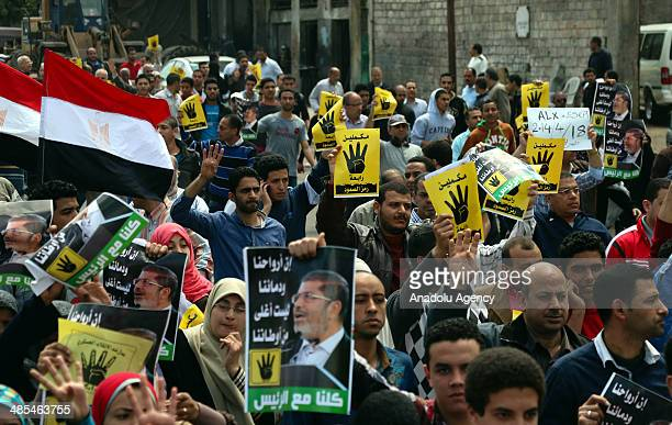 Anticoup Egyptians make 'Rabia' sign as they take part in a rally following the friday prayer in Alexandria Egypt on April 18 2014