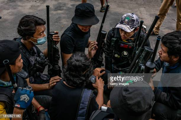 Anti-coup protesters hold improvised weapons during a protest in Yangon on April 03, 2021 in Yangon, Myanmar. Myanmar's military Junta continued a...