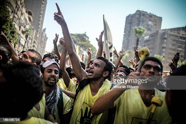 CONTENT] Anticoup protesters march in Cairo in symbolic yellow shirts to commemorate the Rabaa Adaweya massacre which led to the death of at least...