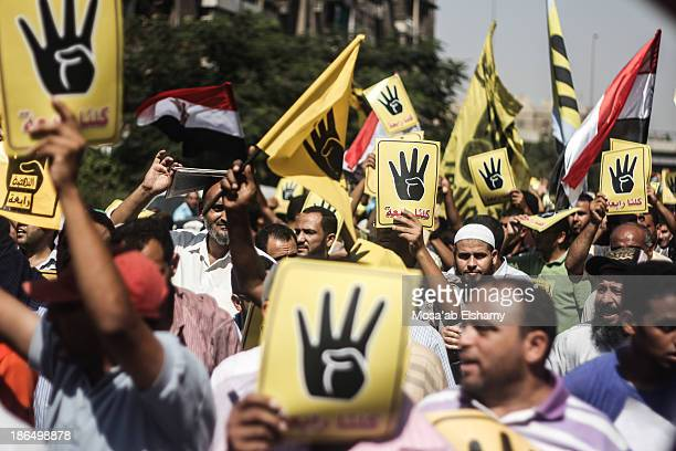 Anti-coup protesters march in Cairo in symbolic yellow shirts to commemorate the Rabaa Adaweya massacre which led to the death of at least 800...