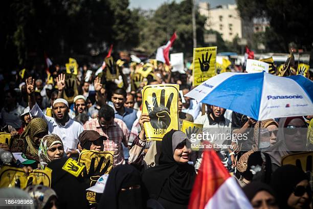 CONTENT] Anticoup protesters march in Cairo with the symbolic four finger Rabaa sign