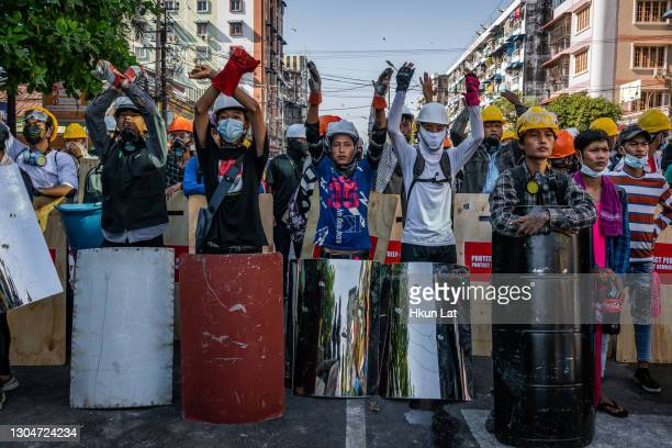 Anti-coup protesters retreat after riot police charged at them on March 01, 2021 in Yangon, Myanmar. Myanmar's military government has intensified a...
