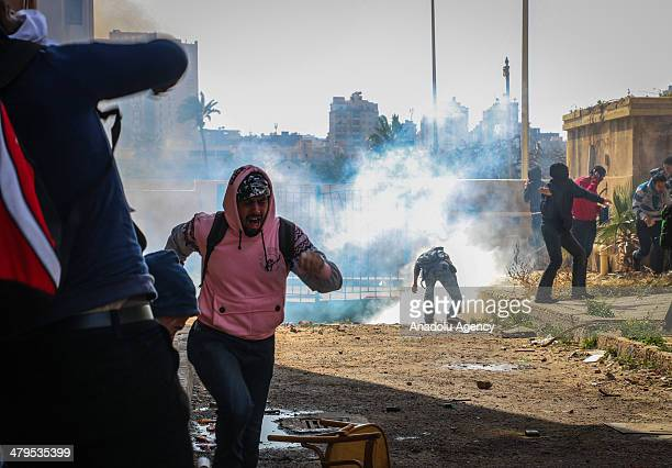 Anticoup students stage protests at Alexandria University in Egypt on March 19 2014 Egyptian security interferes students with tear gas and pumprifle
