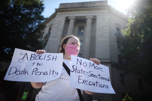 DC: Activists Protest Outside U.S. Justice Department Ahead Of Federal Execution