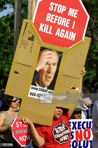 Antideath penalty demonstrators carry signs during a march June 10 2001 near St Margaret Mary Parish in Terre Haute Indiana Convicted Oklahoma City...