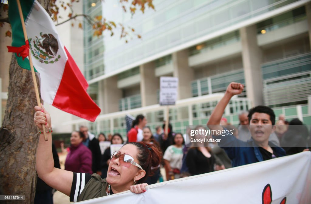 Anti-Donald Trump demonstrators chant during a rall on March 12, 2018 in San Diego, California. The rally was held on the eve of President Trump's visit to California where he will be viewing prototypes of a border wall between Mexico and the United States, and then attending a fund-raiser in Beverly Hills.