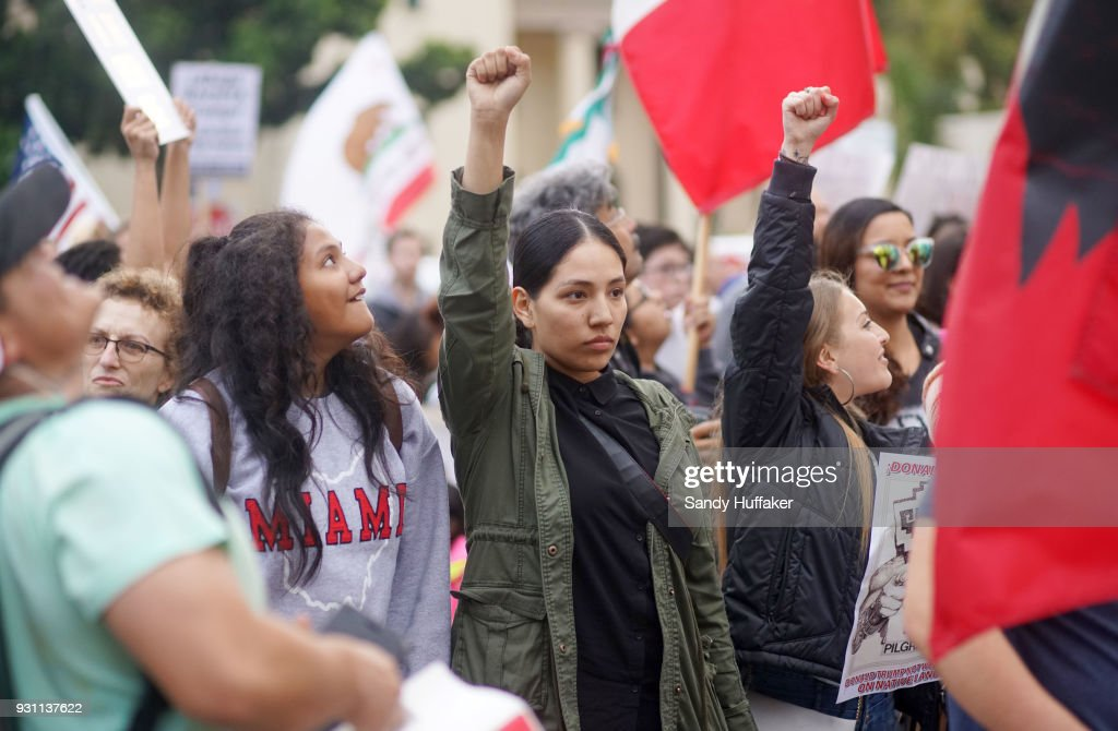 Anti-Donald Trump demonstrators chant during a rally on March 12, 2018 in San Diego, California. The rally was held on the eve of President Trump's visit to California where he will be viewing prototypes of a border wall between Mexico and the United States, and then attending a fund-raiser in Beverly Hills.