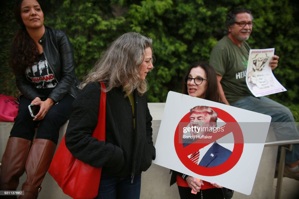 Anti-Donald Trump demonstrators during a rally on March 12, 2018 in San Diego, California. The rally was held on the eve of President Trump's visit to California where he will be viewing prototypes of a border wall between Mexico and the United States, and then attending a fund-raiser in Beverly Hills.