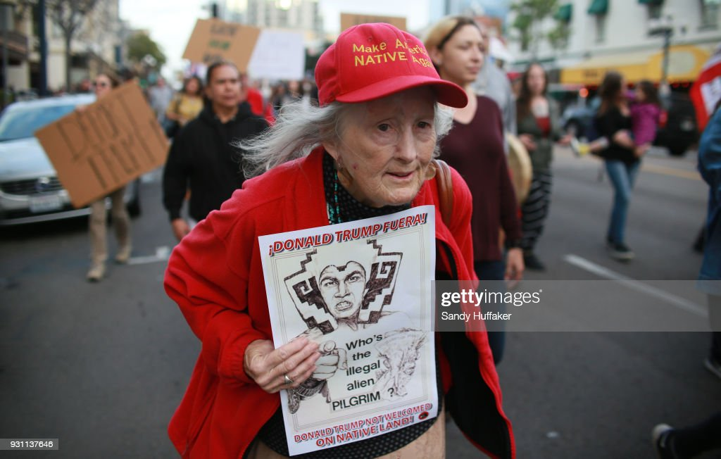 Anti-Donald Trump demonstrators march during a rally on March 12, 2018 in San Diego, California. The rally was held on the eve of President Trump's visit to California where he will be viewing prototypes of a border wall between Mexico and the United States, and then attending a fund-raiser in Beverly Hills.