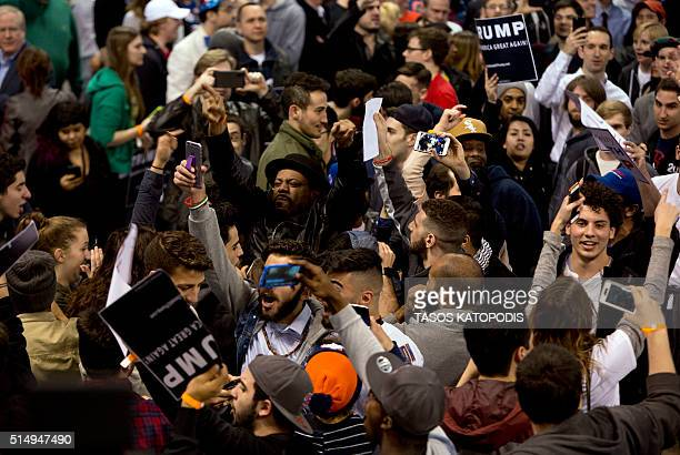 AntiDonald Trump protesters confront with his supporters during a Trump rally at the UIC Pavilion in Chicago on March 11 2016 Republican White House...