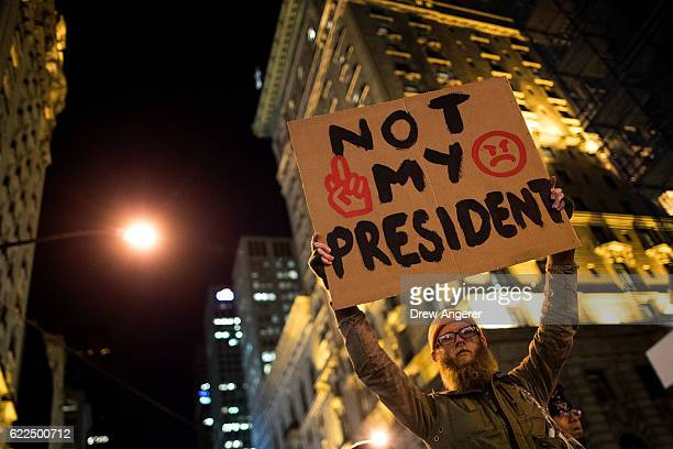 AntiDonald Trump protesters march in the street on Fifth Avenue November 11 2016 in New York City The election of Trump as president has sparked...