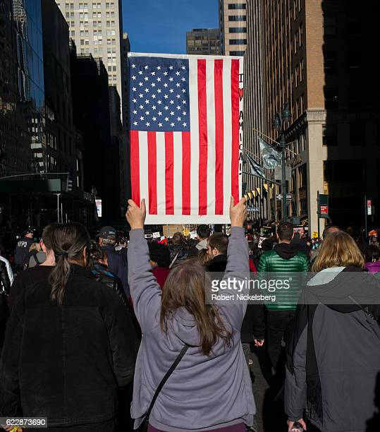 Anti-Donald Trump protesters march up 5th Avenue to Trump Towers November 12, 2016 in New York City. The election of Trump as president has sparked...