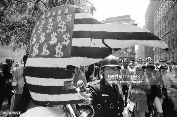 Anti-Draft protesters and supporters of Doctor Benjamin Spock and William Sloane Coffin, Junior, both convicted of conspiracy to counsel young men to...