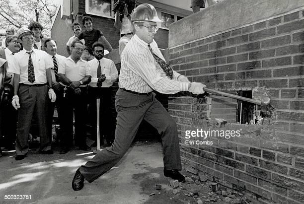Antidrug blow Toronto Mayor Art Eggleton Swings a sledgehammer yesterday to help start demolishing walls at Alexandra Park that residents say conceal...
