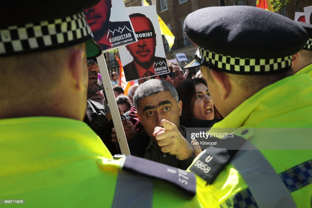 Anti-Erdogan protesters clash with police outside Downing Street as Turkish President Recep Tayyip Erdogan meets the Prime Minister, on May 15, 2018 in London, England. Turkish President Mr Erdogan is in the UK for a three-day visit, which includes a closing lecture at the Tatlidil Forum in Oxford, an audience with The Queen and talks with British Prime Minister Theresa May.