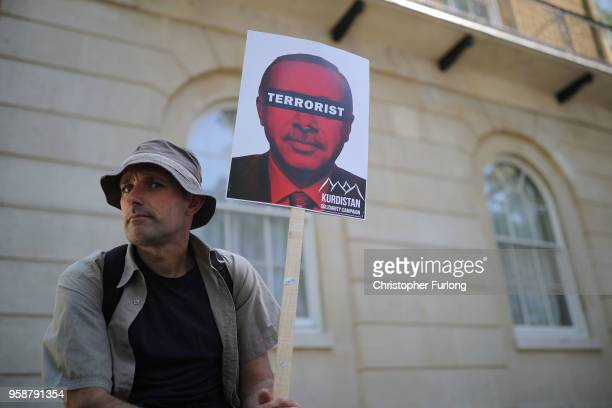 AntiErdogan protesters demonstrate on Whitehall outside Downing Street as Turkish President Recep Tayyip Erdogan meets the Prime Minister on May 15...