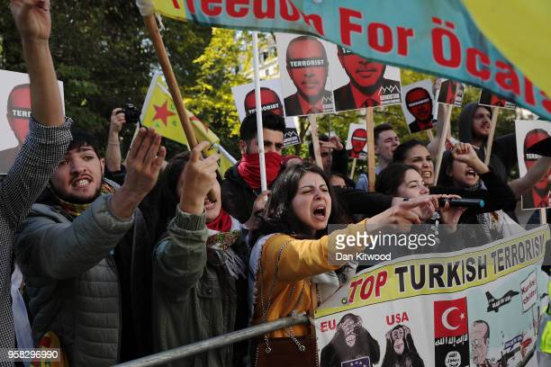 AntiErdogan protesters gather outside Chatham House ahead of a visit by the Turkish President Recep Tayyip Erdogan on May 14 2018 in London England...