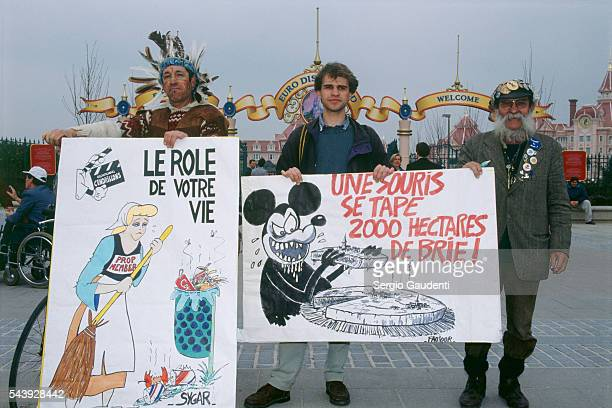 AntiEuro Disney protestors picket outside the amusement park grounds