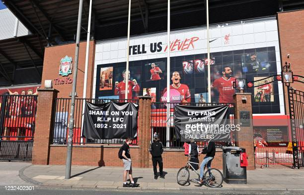 Anti-European Super League posters hang outside Anfield stadium, home of English Premier League football club Liverpool, in Liverpool, north west...