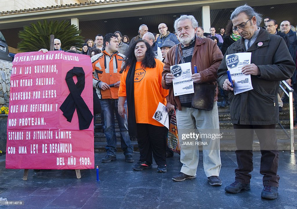 Anti-eviction activists observed a minute of silence in the City Hall of Calvia, on Balearics Islands on February 13, 2013. A retired couple in Spain killed themselves on February 12, 2013 because they faced eviction, police said, as lawmakers considered legislation to save ruined homeowners from being thrown into the street.