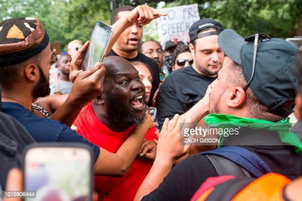 Antifa and counter protestors to a far-right rally argue during the Unite the Right 2 Rally in Washington, DC, on August 12, 2018. - Last year's...