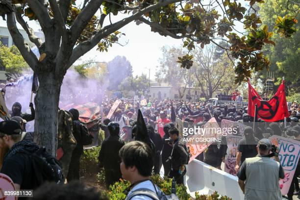 Antifa members and counter protesters gather at the rightwing No To Marxism rally on August 27 2017 at Martin Luther King Jr Park in Berkeley...