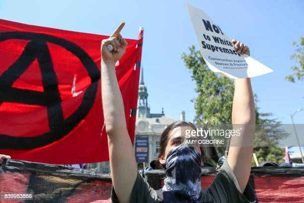 Antifa members and counter protesters gather during a rightwing NoToMarxism rally on August 27 2017 at Martin Luther King Jr Park in Berkeley...