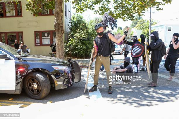 Antifa members prepare for confrontation during a rightwing NoToMarxism rally on August 27 2017 at Martin Luther King Jr Park in Berkeley California...