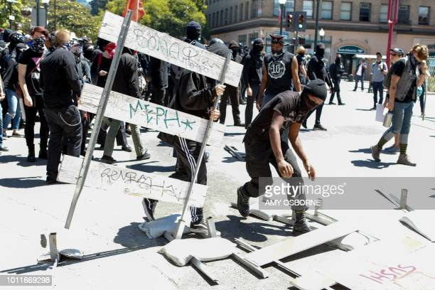 Antifa militants overthrow street barricades as they march with counter protesters during an altright rally on August 5 2018 in downtown Berkeley...