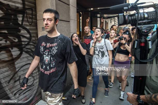 Anti-fascist activists shout at a man who is claimed to be a right-wing sympathiser as he walks from the scene of yesterday's terrorist attack on Las...