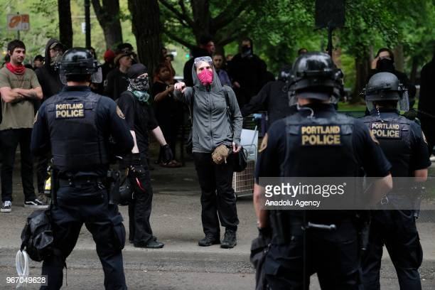 Antifascist counterprotesters face off with farright Patriot Prayer supporters mediated with riot police during a freedom march on June 03 2018 in...