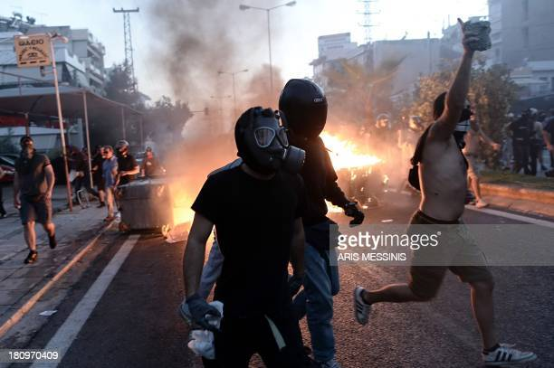 Anti-fascist demonstrators clash with riot police in Athens on September 18 after a leftist musician was murdered by a suspected neo-Nazi. Pavlos...