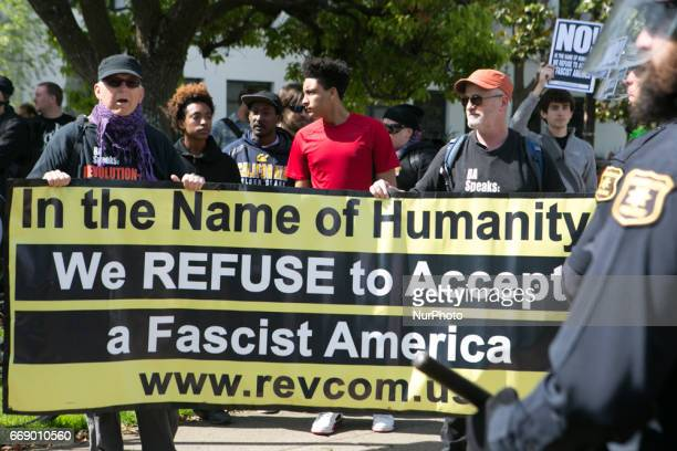Antifascist protesters hold a sign and chant during a free speech rally at Martin Luther King Jr Civic Center Park in Berkeley California United...