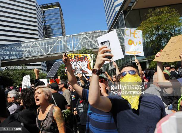 Antifascist protestors gather as rightwing rally organizer Patriot Prayer founder and Republican Senate candidate Joey Gibson speaks during a...