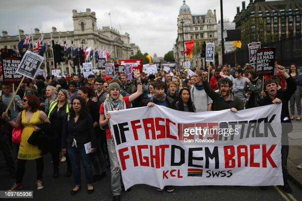 Antifascist protestors gather outside the Houses of Parliament on June 1 2013 in London England Dozens of police officers attended a protest by the...