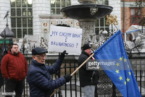 Antifascist rally participant with European Union flag and banner that speaks You want a Good which one Brown is seen in Gdansk Poland on 19 November...