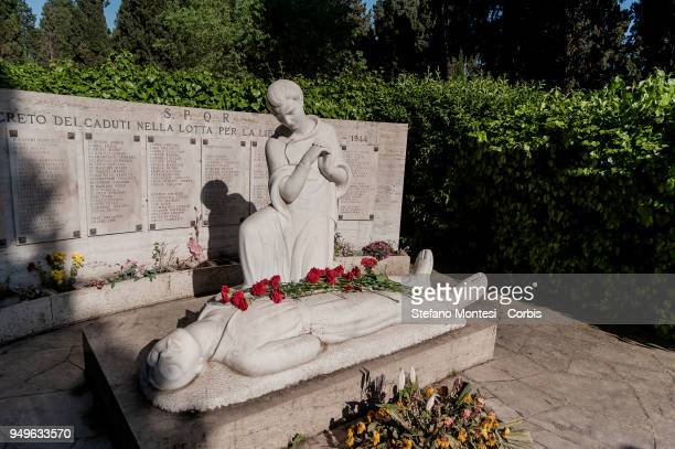 Anti-Fascists lay a flower on the monument to the partisans in the Verano cemetery during the parade in remembrance of the struggle for liberation...
