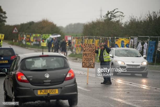 Antifracking protesters gather near the entrance to the Preston New Road drill site where energy firm Cuadrilla Resources are preparing to commence...