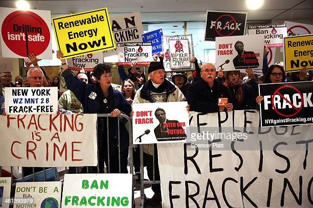 Antifracking protesters gather outside of the auditorium before New York Gov Andrew Cuomo gives his fourth State of the State address on January 8...