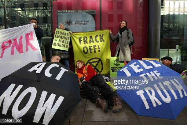 Antifracking protesters hold a demonstration outside Department for Business Energy and Industrial Strategy in central London on November 12 to show...