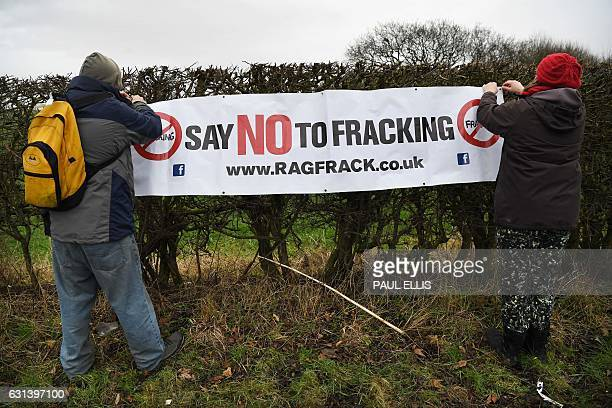 Antifracking protesters put up a banner at the Preston New Road site where Energy firm Cuadrilla are setting up fracking operations at Little...