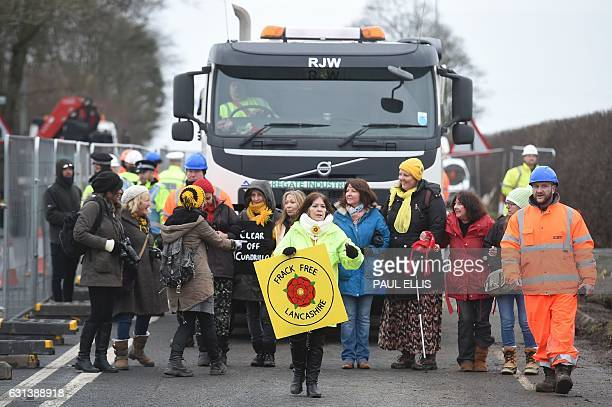 Antifracking protesters walk in a line in front of a truck at the Preston New Road site where Energy firm Cuadrilla are setting up fracking...