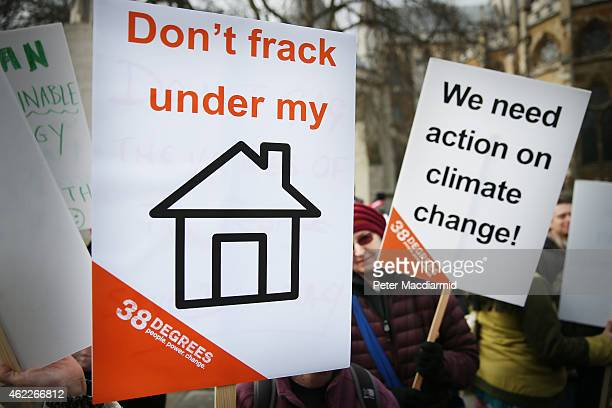 Antifracking protestors gather near Parliament on January 26 2015 in London England Protestors plan to lobby Parliament and hand in a petition...