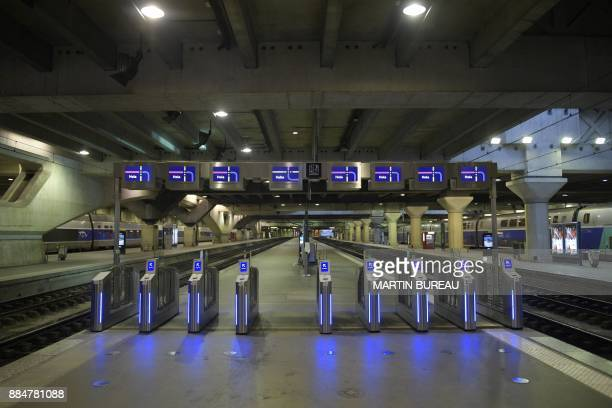 Antifraud gates at the entrance of a quay are pictured at the Montparnasse train station in Paris on December 3 as rail traffic was interrupted due...
