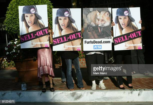 PETA antifur campaigners demonstrate against model Cindy Crawford at 1200 Sunset Marquis August 26 2004 in Los Angeles California Cindy who once...