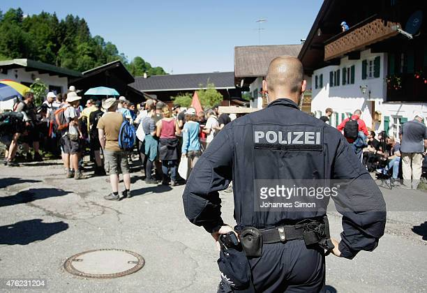 AntiG7 protesters are stopped by riot police in a forest near the perimeter of Schloss Elmau venue of the summit of G7 nation leaders on the first...
