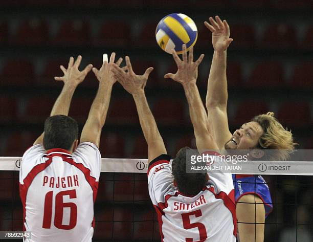 Antiga Stephane of France hits the ball as Pajenk Alen and Satler Rok of Slovenia block during their 2007 Men's European Championships qualification...